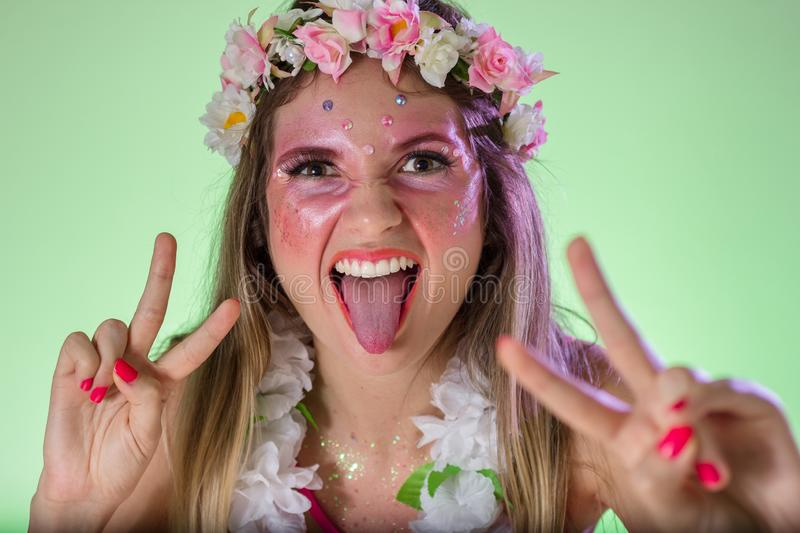Hands and gesture: Crazy. Portrait of brazilian woman with bright makeup. Colorful background. Carnival concept, fun and party. Carnaval Brazil. Hands and stock image