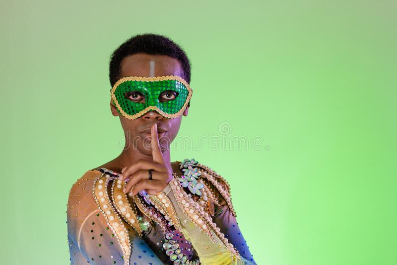 Hands and gesture, silence, quiet. Face of brazilian man wearing costume. Bright background. Party concept, celebration and. Carnaval Brazil. Hands and gesture royalty free stock photos