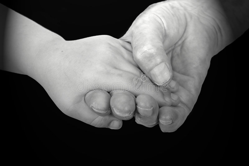Hands of the girl and the grandmother royalty free stock image
