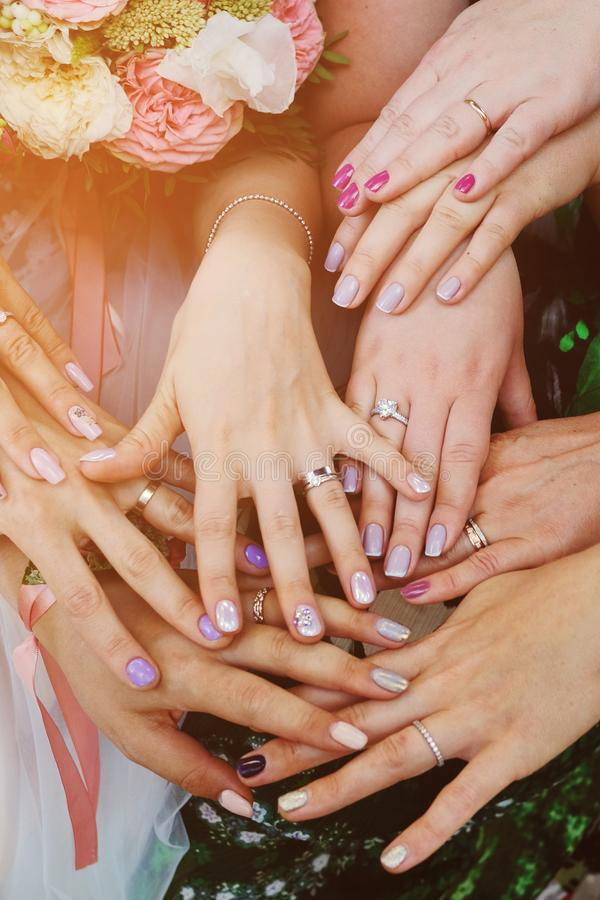Hands of girls with rings at the wedding. Bridesmaid. Wedding.  royalty free stock images