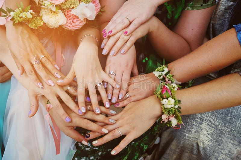Hands of girls with rings at the wedding. Bridesmaid. Wedding.  royalty free stock image