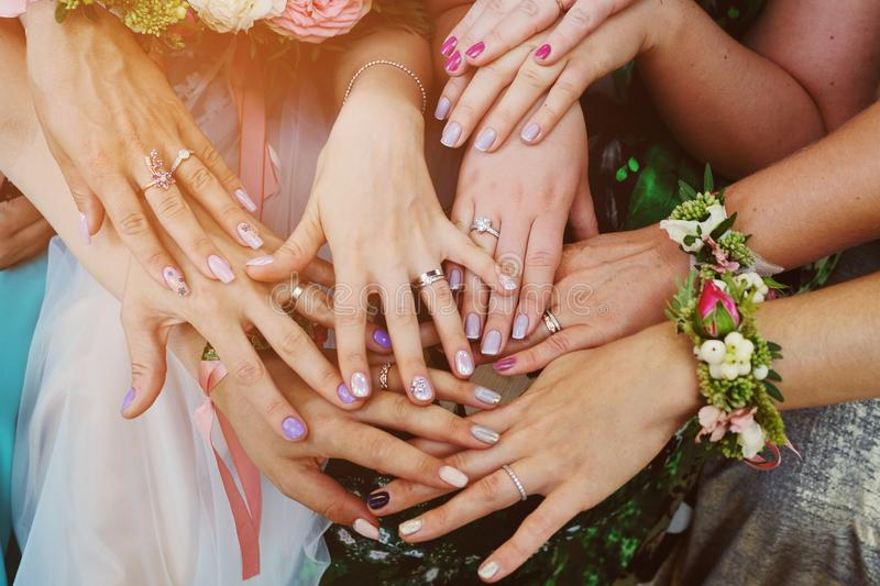 Hands of girls with rings at the wedding. Bridesmaid. Wedding.  stock images