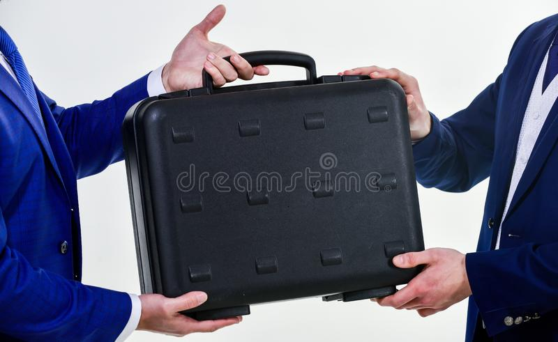 Hands give briefcase for exchange or offer bribe. Business transfer concept. Male hand hold briefcase. Handover of case royalty free stock image
