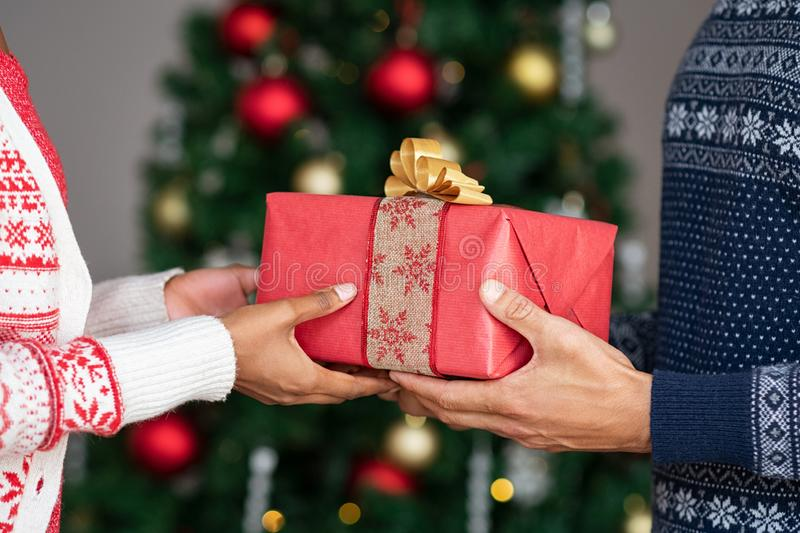 Hands giving christmas gifts stock images