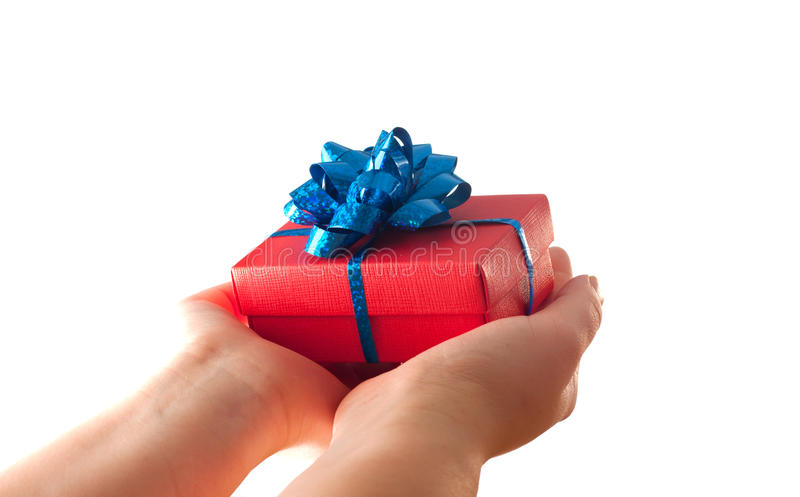 Hands giving a gift stock image