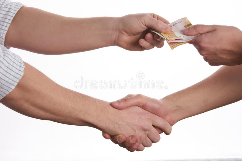 Hands giving money. Shaking hands isolated on white background stock photo