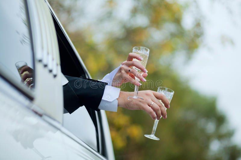 Hands with glasses of champagne stock photos