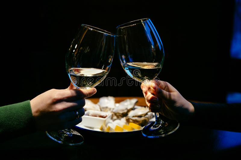 Family couple drinking champagne from goblets stock photography