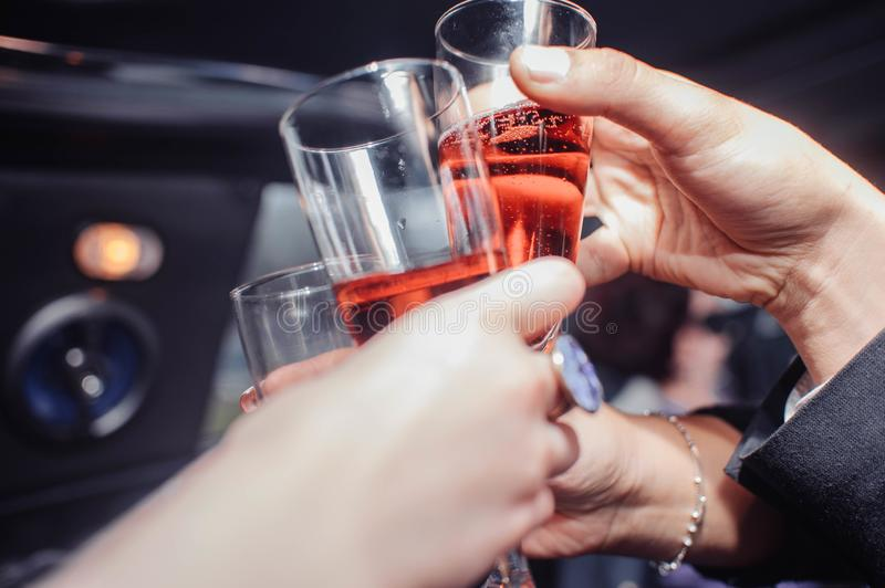 Hands with glasses of pink champagne stock image