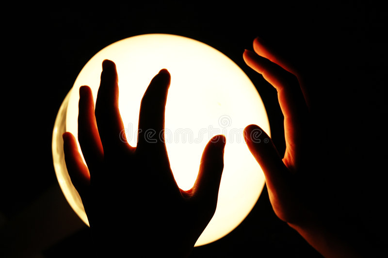 Download Hands on a Glowing Globe stock image. Image of lighted - 191423