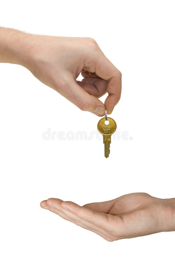 Hands and golden key. Isolated on white background stock photography
