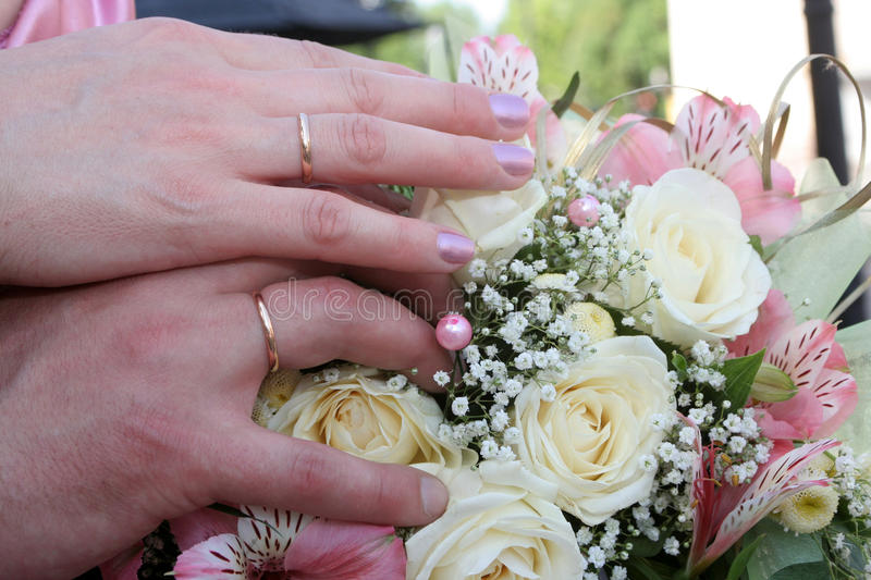 Hands of the groom and the bride. With wedding rings royalty free stock photo
