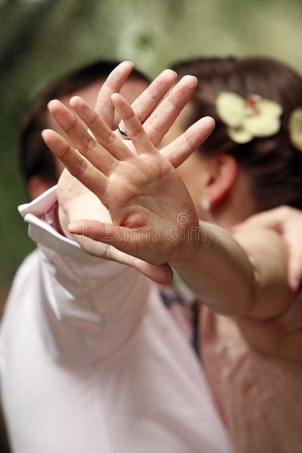 Hands of the groom royalty free stock image