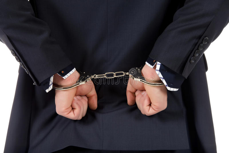 Hands in handcuffs stock image