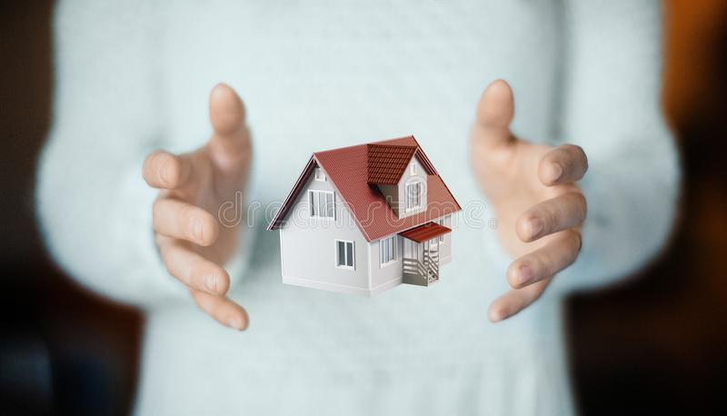 House on hand, buy new home, apartment. Hands with haouse, new home, sold or rent royalty free stock image