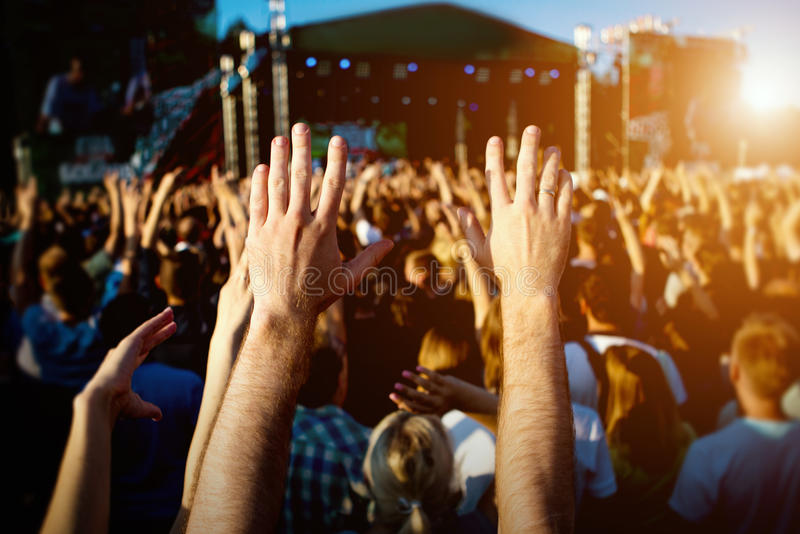 Hands of happy people crowd having fun at summer live rock fest royalty free stock images