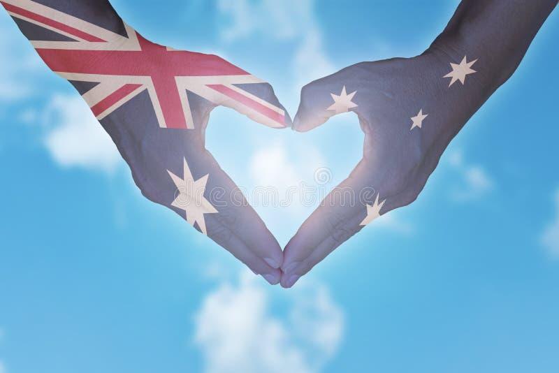 Hands in heart shaped. Australia day. Australian flag painted on hands in heart shaped. Australia day stock photo