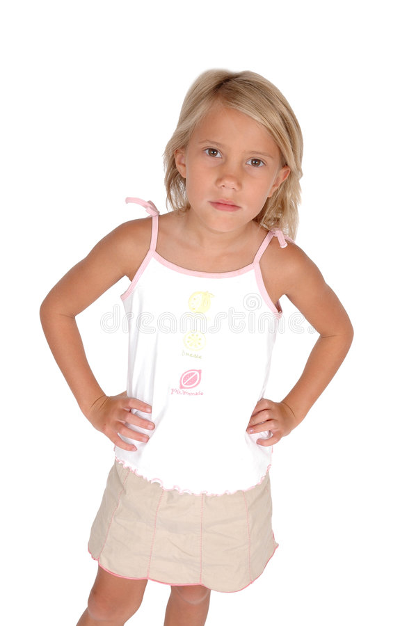 Hands on hips. Child stands with questionable look on her face and hands on hips. Young child. On white background. The ability to apprehend or understand royalty free stock image