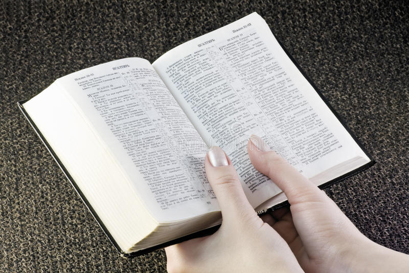 Hands hold the Bible. Hand holds the bible on the background fabric royalty free stock photography