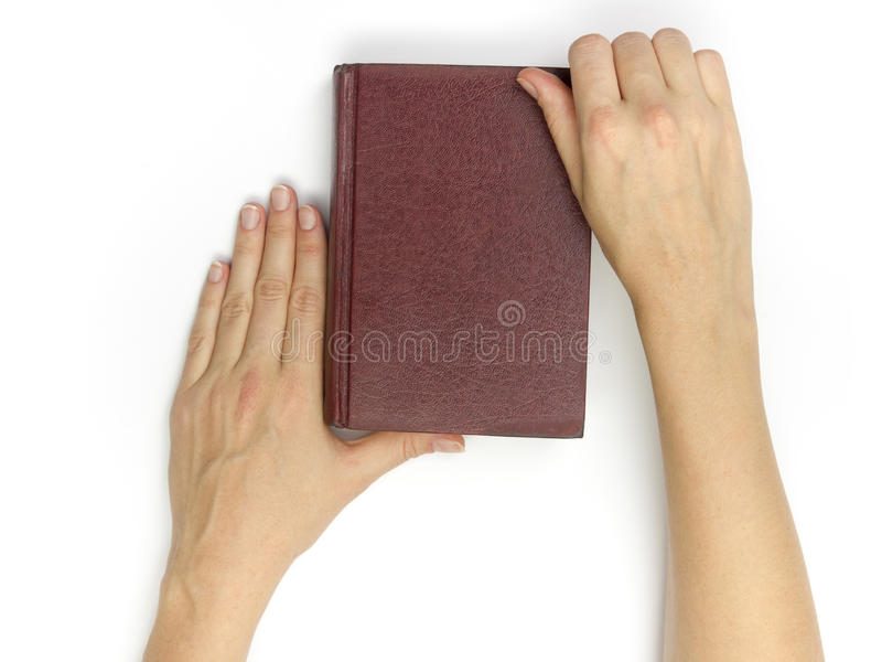 Hands hold blank red hardcover book on white background royalty free stock image