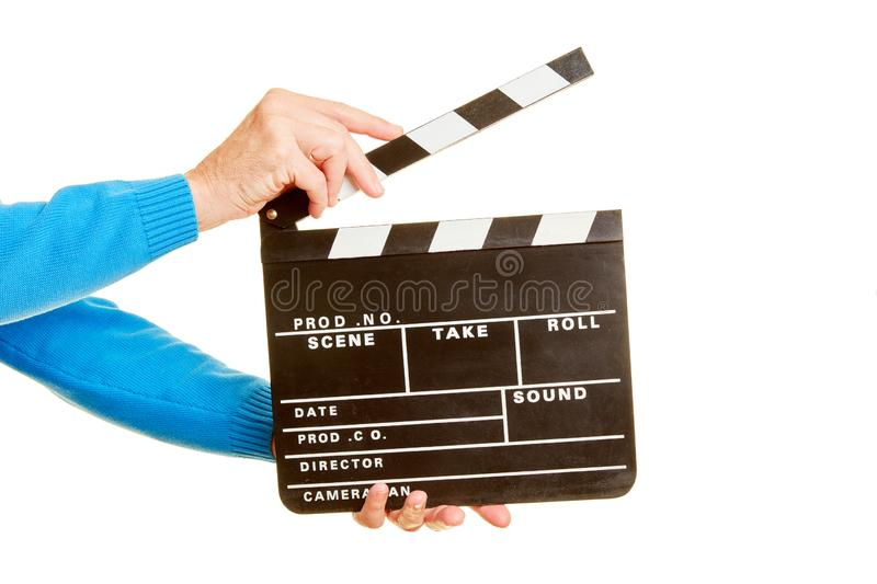 Hands hold clapperboard for filming. Two hands hold film flap for filming royalty free stock photo