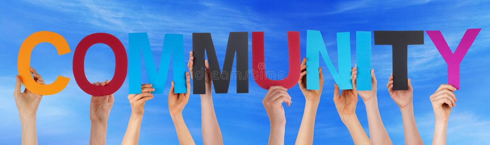 Hands Hold Colorful Straight Word Community Sky. Many Caucasian People And Hands Holding Colorful Straight Letters Or Characters Building The English Word royalty free stock image