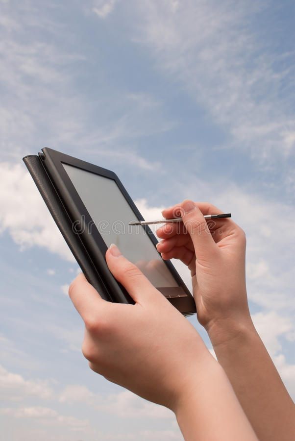 Hands hold electronic book reader royalty free stock images
