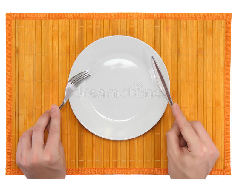 Hands hold fork and knife stock photography