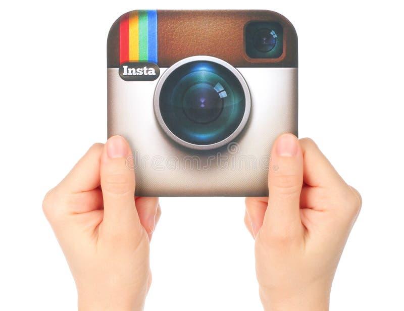 Hands hold Instagram logo stock images