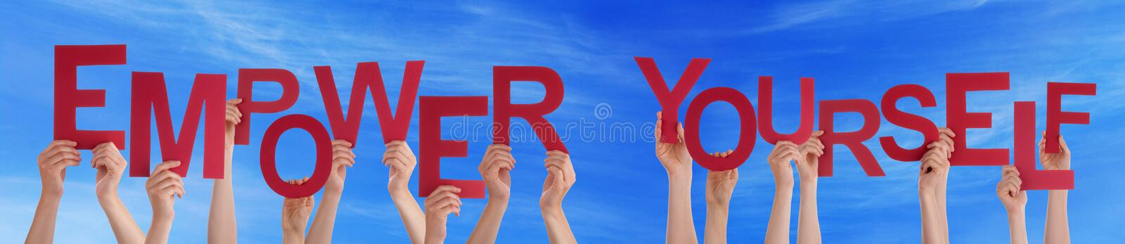 Hands Hold Red Word Empower Yourself Blue Sky stock photos