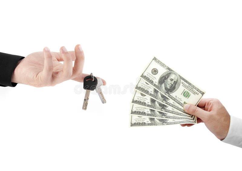 Hands holdind money and car keys. Isolated on white background royalty free stock images