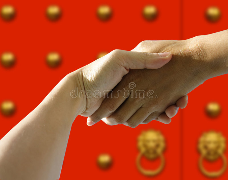 Hands holding stock photos