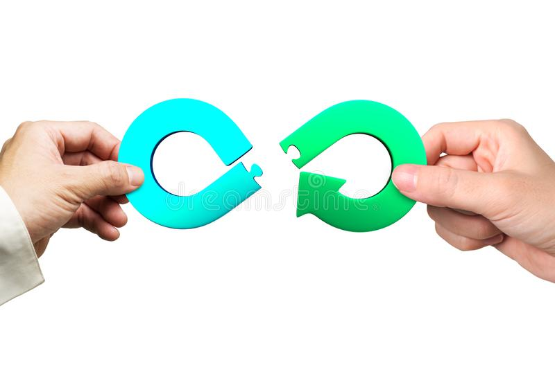 Hands holding arrow infinity jigsaw puzzle pieces, Circular economy concept. Circular economy concept. Male and female hands assembling arrow infinity recycling stock photos