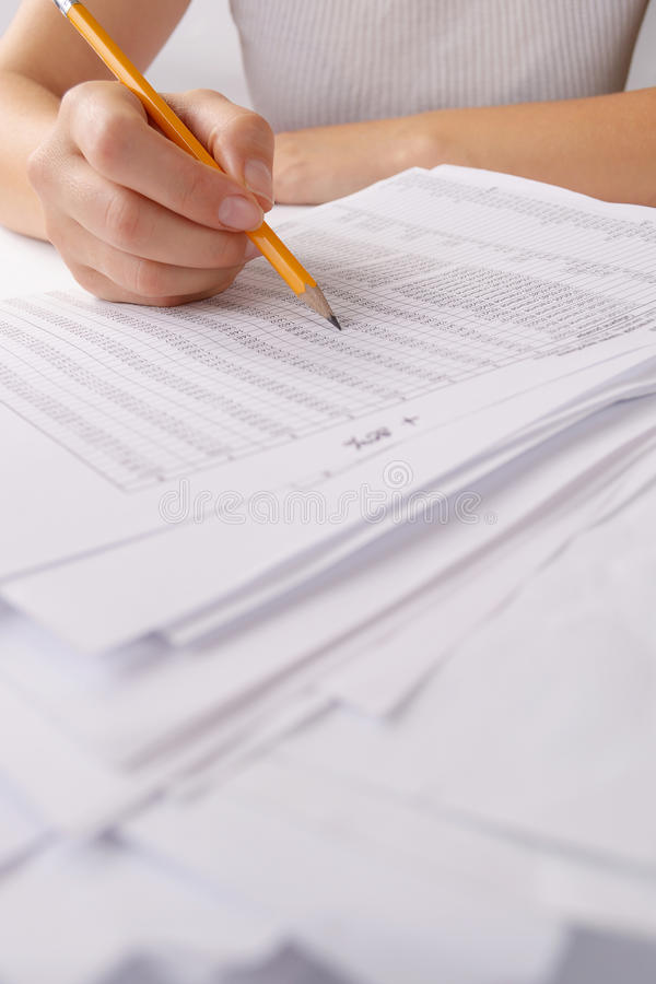Hands holding a batch of loose paperwork stock images