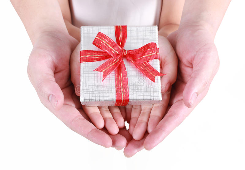 Hands holding beautiful gift box royalty free stock photography