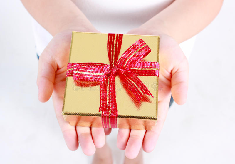 Hands holding beautiful gift box. stock photo