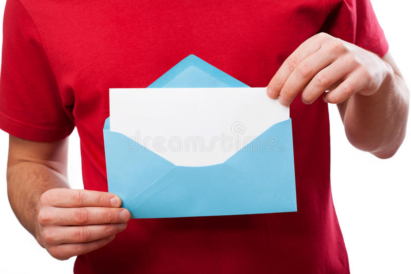 Hands holding a blank letter. For your text in an blue envelope stock photos