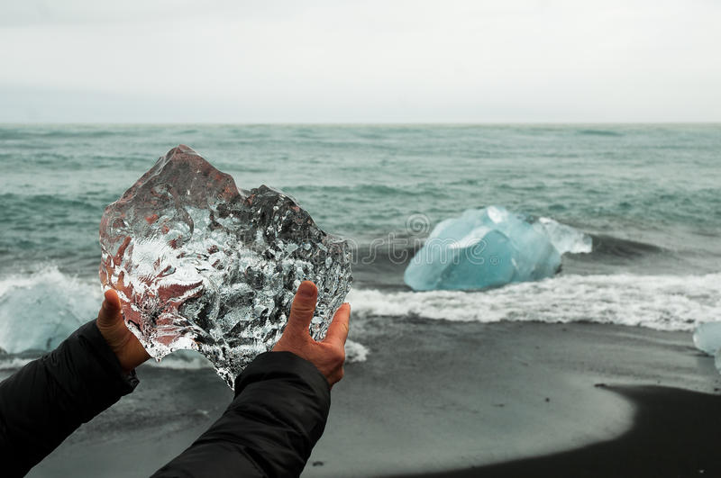 Hands Holding A Block Of Pristine Glacier Ice Stock Photography
