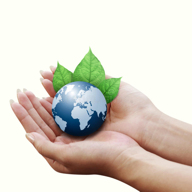 Hands holding blue earth with a leaf royalty free stock photos