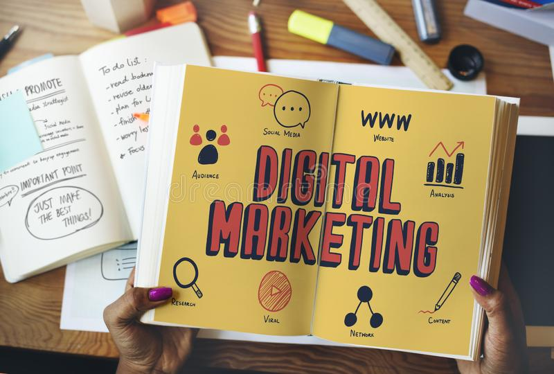 Hands holding a book on a digital marketing content page stock photo