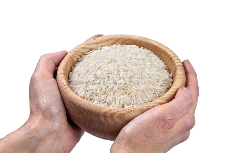 Hands holding bowl of rice