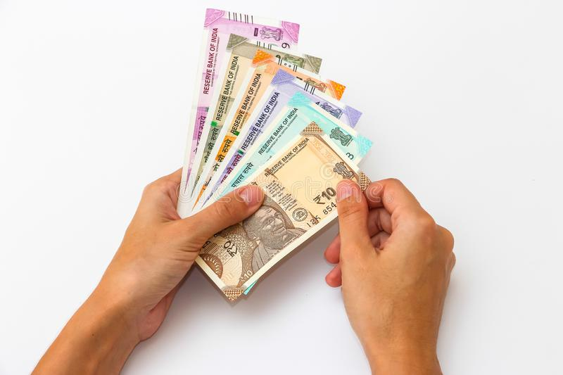 Hands holding brand new 10, 50, 100, 200, 500 and 2000 indian rupees banknotes. Female hands holding brand new 10, 50, 100, 200, 500 and 2000 indian rupees stock photos