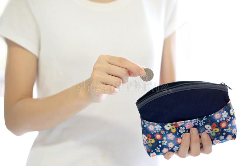 Hands holding british coin and small money. Pouch stock photo