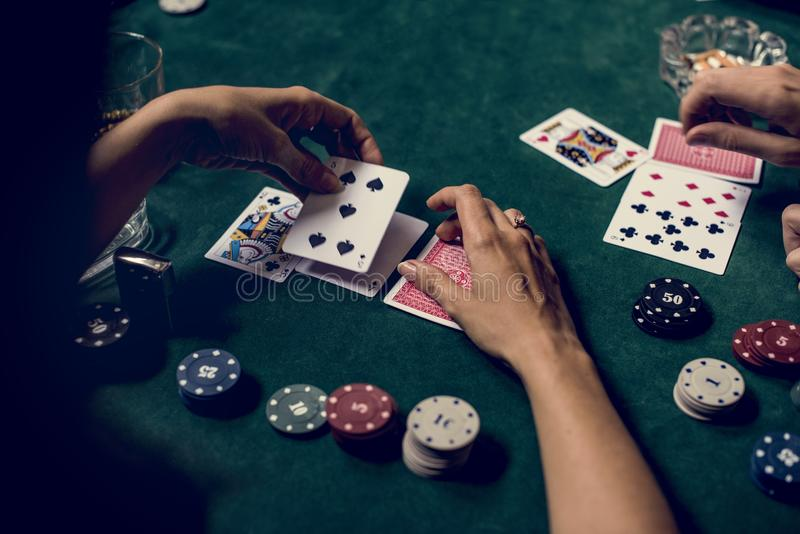 Hands holding card on gambling game stock photo