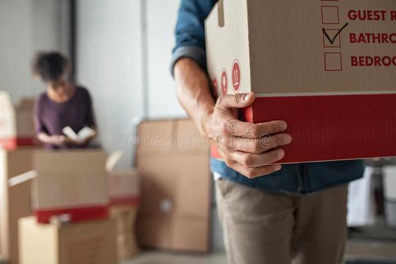 Hands holding cardboard box during relocation royalty free stock photos