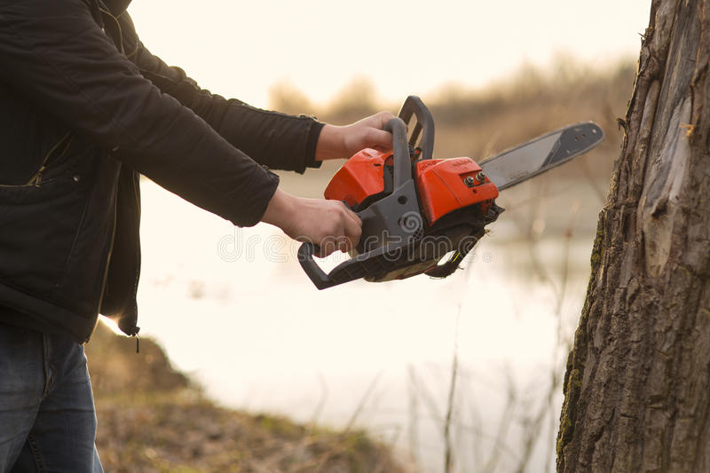 Hands holding a chainsaw stock photos