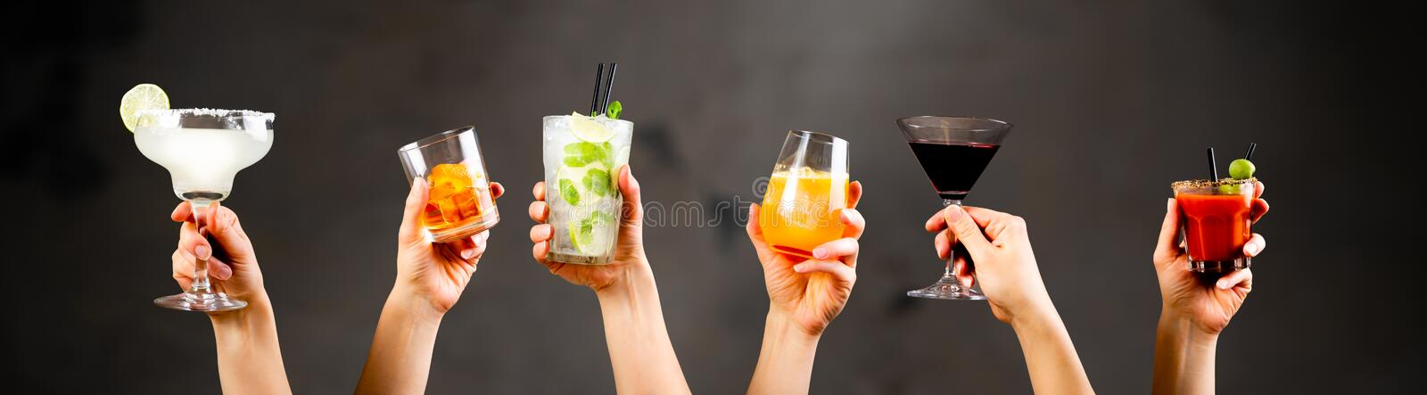 Hands holding classic cocktails on rustic background stock images
