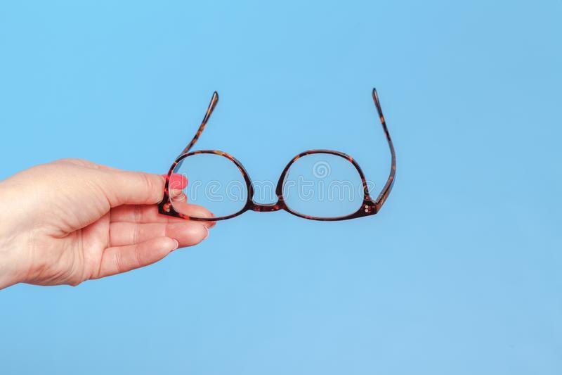 Hands holding classic styled glasses stock photos