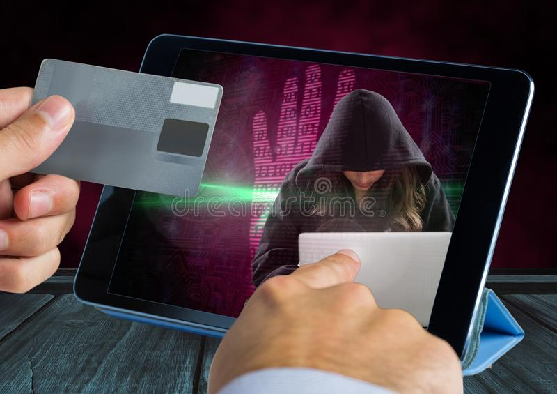 Hands holding a credit card and touching a tablet with a woman hacker on the screen. Digital composite of Hands holding a credit card and touching a tablet with stock photos