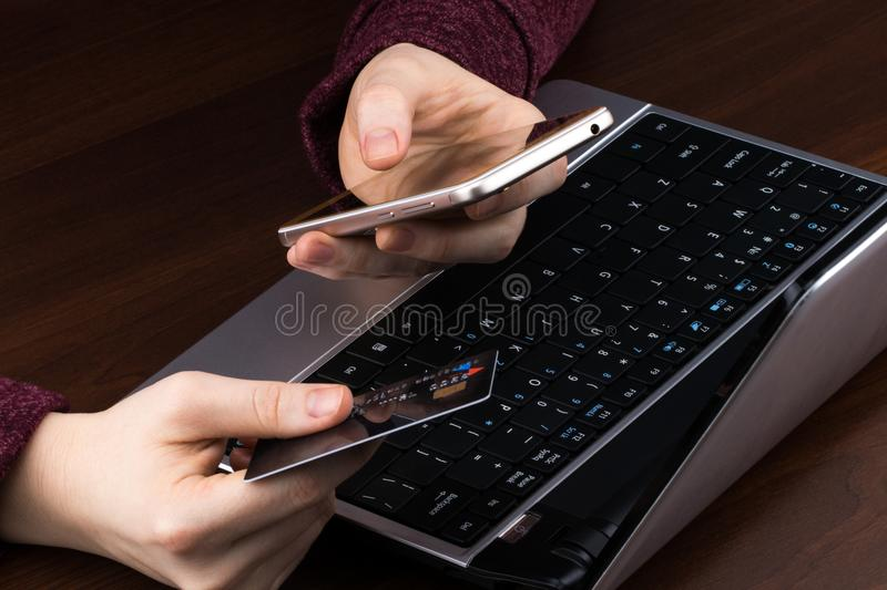 Hands holding credit card and using laptop. Online shopping.  stock photos